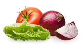 Tomato with green leaf, onion with slice and green salad. Whole fresh red tomato with green leaf, unpeeled red onion with slice and green salad isolated on white Stock Photography