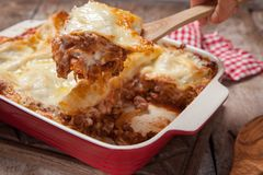 Tomato and ground beef lasagne rolls. With cheese layered between sheets of traditional Italian pasta royalty free stock photography