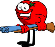 Tomato with a gun Royalty Free Stock Photos