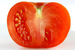 Tomato Half. Closeup of Tomato Sliced in Half Stock Photography