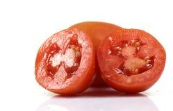 Tomato halves. Isolated on white background Royalty Free Stock Images