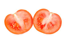 Tomato halves on a white background Royalty Free Stock Photo