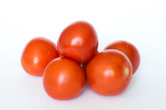 Tomato. A handful of tomato on white background Stock Image