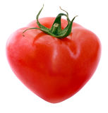 Tomato heart. Isolated over the white background royalty free stock photography