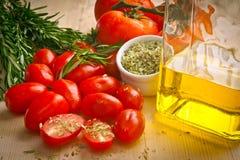 Tomato and herbs Stock Photos