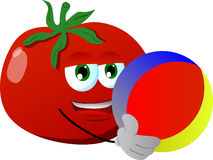 Tomato holding a beach ball Royalty Free Stock Photo