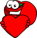 Tomato holding a big red heart Royalty Free Stock Images
