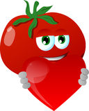 Tomato holding a big red heart Royalty Free Stock Image