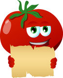 Tomato holding a blank old paper Royalty Free Stock Image