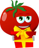 Tomato holding gift box Royalty Free Stock Image