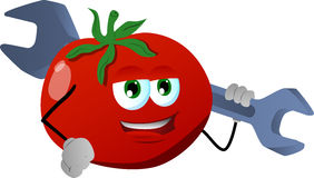 Tomato holding a huge wrench Royalty Free Stock Photo