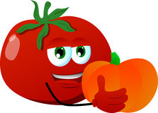 Tomato holding pumpkin Royalty Free Stock Images