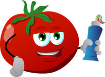 Tomato holding toothpaste Royalty Free Stock Images
