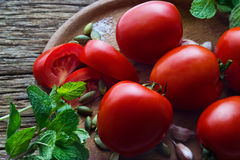 Tomato and ingredient in wood plate on wooden table background Stock Images