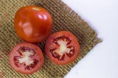 Tomato isolated on white. With clipping path,Tomato paste sack o Royalty Free Stock Photos