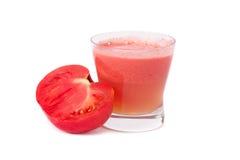 Tomato juice. A glass of fresh tomato juice isolated on white background Royalty Free Stock Photo