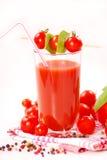 Tomato juice. With cherry tomatos decoration on white background Stock Photo