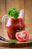 Tomato Juice. Freshly prepared in glass jug with parsley garnish Stock Photography