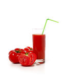 Tomato juice. A glass of tomato juice and tomatoes on a white background Stock Image