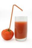Tomato juice. Extracting tomato juice into a glass stock photos