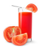 Tomato juice. Isolated juice. Glass of tomato juice and cut tomatoes isolated on white background Royalty Free Stock Images