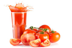 Tomato juice. Ripe tomatoes and glass of  with splash isolated on white background Stock Photo