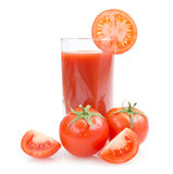 Tomato juice. Glass with tomatoes Royalty Free Stock Images