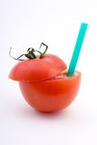 Tomato juice. Tomato with a straw sticking out, isolated on white Stock Photo