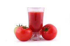 Tomato juice. And fresh tomatoes isolated on white Stock Photography