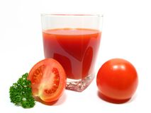 Tomato juice. Tomatos and parsley leaves. Wholesome drink and nourishment. Dieted drink Royalty Free Stock Images