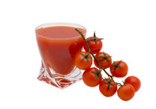 Tomato juice. Glass of tomato juice and tomatoes on a white background Stock Photo