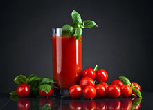 Tomato juice with basil stock photography