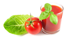 Tomato juice with basil, ripe tomato and salad leaf Royalty Free Stock Photography