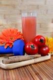 Tomato juice. Beautiful shot of tomato juice with fresh tomatoes Royalty Free Stock Photography