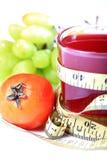 Tomato juice. Beautiful shot of measuring tape wrapped around tomato juice glass Stock Image