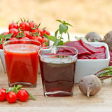 Tomato juice and beet juice Royalty Free Stock Images