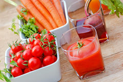 Tomato juice and beet juice Stock Images