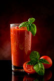 Tomato Juice- Bloody Mary Cocktail. Photo of delicious tomato bloody mary cocktail on reflecting glass table with spot light stock photography
