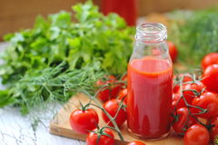 Tomato juice in bottles Royalty Free Stock Images