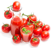 Tomato juice with branch of red tomatoes Royalty Free Stock Image