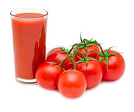 Tomato juice with branch of red tomatoes. Isolated on white background Royalty Free Stock Photos