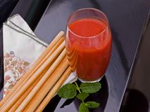 Tomato juice with breadsticks and mint. royalty free stock photo