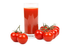 Tomato juice and bunch of tomatoes over white. royalty free stock photo