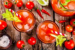 Tomato juice with celery and ice in glasses Royalty Free Stock Photography