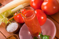 Tomato juice with celery still-life. Tomato juice with celery top view Royalty Free Stock Photography