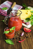 Tomato juice with cheese, basil and spices Royalty Free Stock Images