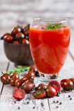 Tomato juice and cherry tomato Stock Photos