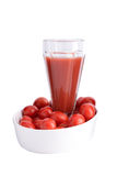 Tomato juice and cherry tomatoes Stock Photo