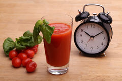 Tomato juice and clock Royalty Free Stock Photo