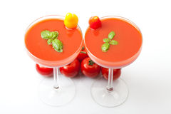 Tomato juice cocktails with fresh basil on white background Royalty Free Stock Images